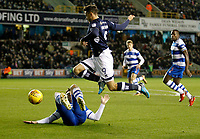 Lee Gregory of Millwall hurdles Grant Hall of Queens Park Rangers during the Sky Bet Championship match between Millwall and Queens Park Rangers at The Den, London, England on 29 December 2017. Photo by Carlton Myrie / PRiME Media Images.