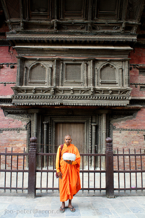 monk waitiung for offerings on Durbar Square, Kathmandu, Nepal, October 2011 (Kabindrapur)
