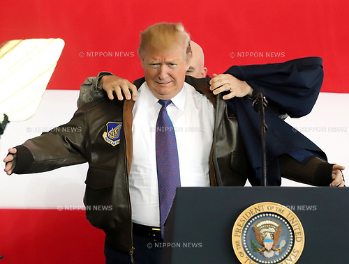 November 5, 2017, Tokyo, Japan - U.S. President Donald Trump wears a flight jacket of the 374th Airlift Wing before he delivers a speech for U.S. soldiers at the Yokota Air Base in Tokyo on Sunday, November 5, 2017. Trump accompanied by his wife Melania arrived here on a three0day official visit to Japan for the first leg of his Asian tour.    (Photo by Yoshio Tsunoda/AFLO) LWX -ytd-
