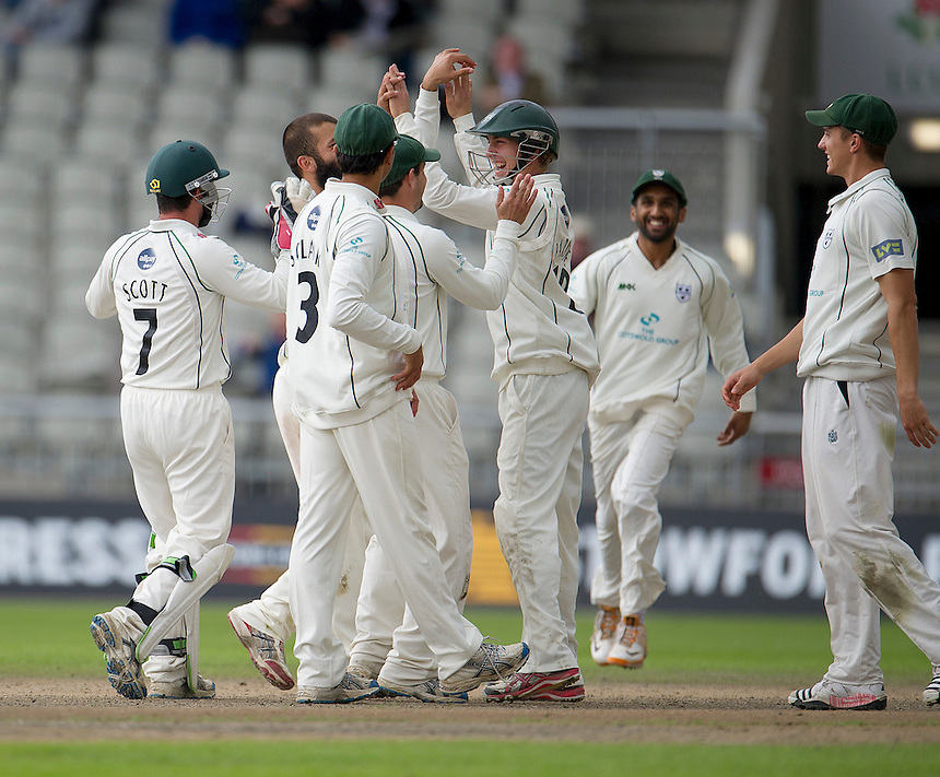 Worcestershire's Matthew Pardoe (R) celebrates his catch to dismiss Lancashire's Ajmal Shahzad with team-mates - A Shahzad c Pardoe b Ali 0 ..County Cricket - Liverpool Victoria County Championship - Division One - Lancashire v Worcestershire - Day 2 - Thursday 19th July 2012 - Old Trafford - Manchester..