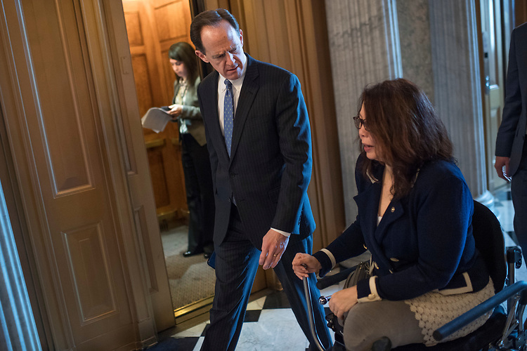 UNITED STATES - MARCH 15: Sens. Pat Toomey, R-Pa., and Tammy Duckworth, D-Ill., make their way to a vote in the Capitol, March 15, 2017. (Photo By Tom Williams/CQ Roll Call)