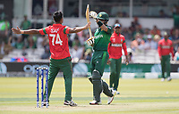 As Mohammad Saifuddin (Bangladesh) celebrates Babar Azam (Pakistan) calls for a review during Pakistan vs Bangladesh, ICC World Cup Cricket at Lord's Cricket Ground on 5th July 2019