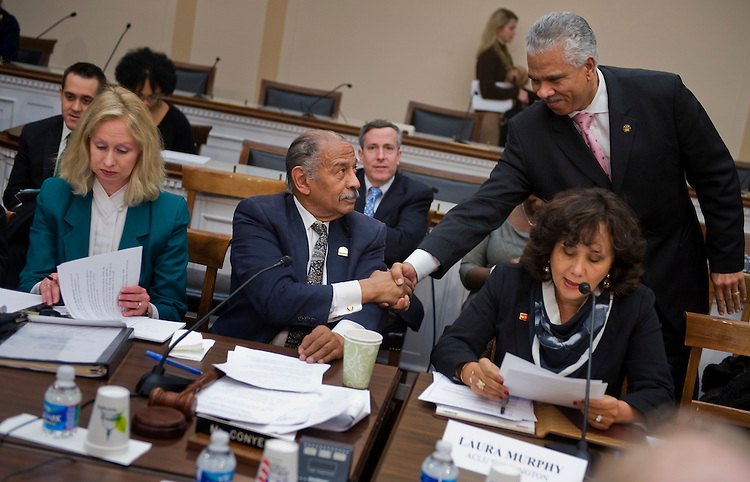 UNITED STATES - FEBRUARY 24:  Rep. John Conyers, D-Mich., seated, ranking member of the House Judiciary Committee greets Hilary Shelton, Washington Bureau Director for the NAACP, during a forum in Rayburn Building on the impact that the Republican's budget proposal will have on job creation, public safety, the nation's justice system, and civil liberties.  (Photo By Tom Williams/Roll Call)