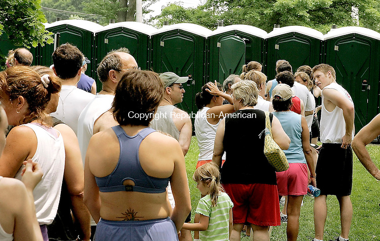 LITCHFIELD, CT - 12 JUNE 2005 -061205JS08--Runners and spectators wait in long lines to use the portable restrooms set up on the Green in Litchfield for the 29th annual Litchfield Hills Road Race on Sunday.    --Jim Shannon Photo-- Litchfield, Litchfield Hills Road Race are CQ