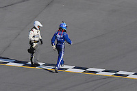 Apr 26, 2009; Talladega, AL, USA; NASCAR Sprint Cup Series driver Carl Edwards runs across the finish line after flipping over on the last lap in the Aarons 499 at Talladega Superspeedway. Mandatory Credit: Mark J. Rebilas-