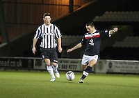 James Thomson passes back under pressure from Jordan Kirkpatrick in the St Mirren v Dundee Clydesdale Bank Scottish Premier League Under 20 match played at St Mirren Park, Paisley on 14.1.13..