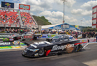 Jun 21, 2015; Bristol, TN, USA; NHRA funny car driver Cruz Pedregon (near lane) races alongside Matt Hagan during the Thunder Valley Nationals at Bristol Dragway. Mandatory Credit: Mark J. Rebilas-