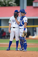Burlington Royals starting pitcher Travis Eckert (23) has a chat with catcher Michael Arroyo (11) during the game against the Bluefield Blue Jays at Burlington Athletic Stadium on June 27, 2016 in Burlington, North Carolina.  The Royals defeated the Blue Jays 9-4.  (Brian Westerholt/Four Seam Images)