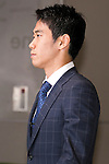 """Japan national football team, Shinji Kagawa, June 27, 2014, Chiba, Japan - Shinji Kagawa arrives at Narita International Airport with other members of the Japan national football team. Members of the Japan national football team arrives at Narita with a disappointed look on their faces. They couldn't advance to the final 16 in """"2014 FIFA World Cup Brazil"""" and came back earlier. (Photo by Rodrigo Reyes Marin/AFLO)"""