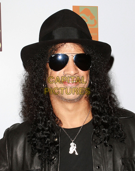 """SLASH (SAUL HUDSON) .Attending the new """"Elephants Of Asia"""" Habitat Unveiling At The L.A. Zoo, The Los Angeles Zoo, Los Angeles, CA , USA, 15th December 2010..portrait headshot  black leather jacket hat sunglasses shirt ray bans aviators necklace nose ring .CAP/ADM/KB.©Kevan Brooks/AdMedia/Capital Pictures."""