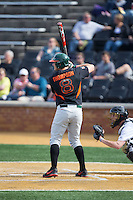 David Thompson (8) of the Miami Hurricanes at bat against the Wake Forest Demon Deacons at Wake Forest Baseball Park on March 21, 2015 in Winston-Salem, North Carolina.  The Hurricanes defeated the Demon Deacons 12-7.  (Brian Westerholt/Four Seam Images)