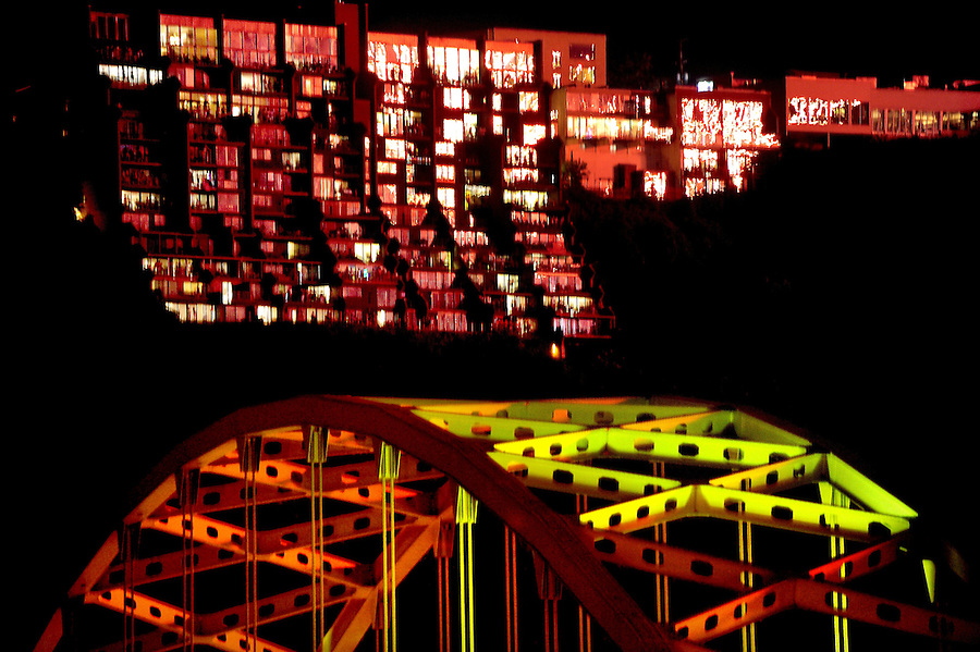 JimMendenhallPhotos.com 2013 July 4, 2013 fireworks  as viewed from Downtown Pittsburgh. The Fort Pitt bridge is in many frames. A multi-unit building on Mt. Washington reflects the fireworks from across the river that are shot from a barge on the north shore.
