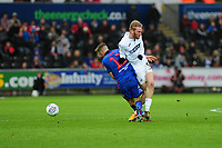 Oli McBurnie of Swansea City is fouled by Craig Noone of Bolton Wanderers during the Sky Bet Championship match between Swansea City and Bolton Wanderers at the Liberty Stadium in Swansea, Wales, UK.  Saturday 02 March, 2019
