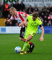 Lincoln City's Terry Hawkridge vies for possession with York City's Simon Heslop<br /> <br /> Photographer Andrew Vaughan/CameraSport<br /> <br /> Buildbase FA Trophy Semi Final Second Leg - Lincoln City v York City - Saturday 18th March 2017 - Sincil Bank - Lincoln<br />  <br /> World Copyright &copy; 2017 CameraSport. All rights reserved. 43 Linden Ave. Countesthorpe. Leicester. England. LE8 5PG - Tel: +44 (0) 116 277 4147 - admin@camerasport.com - www.camerasport.com
