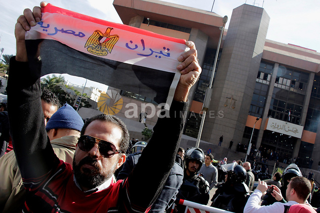 "An Egyptian man celebrates with a national flag defaced with the words ""Tiran is Egyptian"" after the Supreme Administrative Court upheld on January 16, 2017 a ruling voiding a government agreement to hand over the two Red Sea islands of Tiran and Sanafir to Saudi Arabia in a deal that had sparked protests in Egypt. Photo by Stranger"