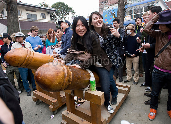 "Women mount a giant-size wooden pahllus in the grounds of Wakamya Hachimangu shrine during the Kanamara Festival in Kawasaki, Japan on 04 April 2010. The fertility festival, often just called the ""penis festival,"" has been held since the early 1600s and also aims to promote awareness of AIDS and STDs.."
