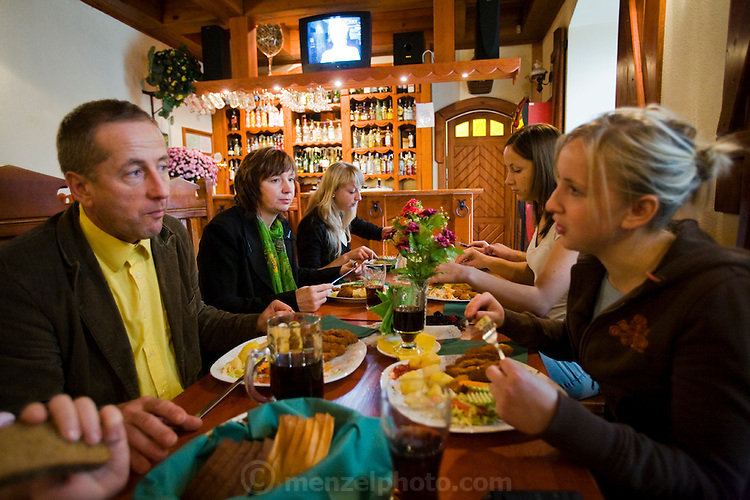 Aivars  Radzins, a forester and beekeeper, with his family at Sunday mid-day meal in a local restaurant in Vecpiebalga, Latvia. (Aivars Radzins is featured in the book What I Eat: Around the World in 80 Diets.)