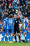 Referee David Fernandez Borbalan shows Florin Andone of RC Deportivo La Coruna the yellow card during the La Liga 2017-18 match between Real Madrid and RC Deportivo La Coruna at Santiago Bernabeu Stadium on January 21 2018 in Madrid, Spain. Photo by Diego Gonzalez / Power Sport Images
