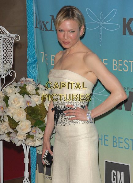 RENEE ZELLWEGER .The Women in Film's 2007 Crystal & Lucy Awards, The Best of The Best of 2007 held at The Beverly Hilton Hotel in Beverly Hills, California, USA..June 14th, 2007.half length beige cream strapless dress black circles white clutch purse diamond bracelet ring hand on hip.CAP/DVS.©Debbie VanStory/Capital Pictures