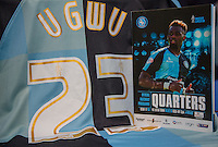 Gozie Ugwu of Wycombe Wanderers  shirt with programme during the Sky Bet League 2 match between Wycombe Wanderers and Luton Town at Adams Park, High Wycombe, England on 6 February 2016. Photo by Massimo Martino / PRiME Media Images.