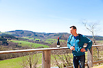 The Wine Route in early spring in Beaujolais, France. Julien Sunier, artisan winemaker (vigneron), at his home and winery in Avenas.  Sunier specializes in wines that are organic and small production.  He makes a Fleurie, a Morgon and a Regnie - all of which are from the ten crus of Beaujolais.