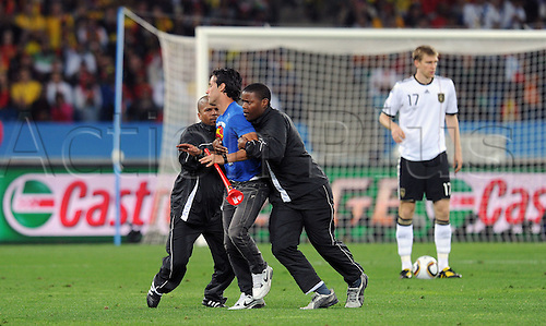A fan invades a pitch during the 2010 FIFA World Cup Semi Final soccer match between Germany and Spain at Princess Magogo Stadium on July 7, 2010 in Durban, South Africa.