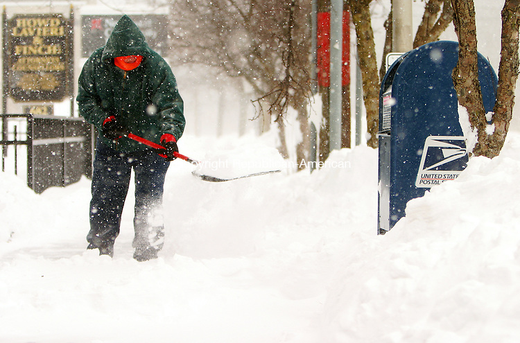 WINSTED, CT, 26 DECEMBER 2010-122710JS01--Jim Rhoades of Winsted clears the sidewalk in front of Moore &amp; Alvord Insurance on Main Street in Winsted Monday morning. The state had to dig out from a powerful storm that dumped more than two feet of snow in some areas. <br />  Jim Shannon Republican-American