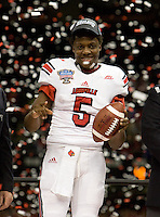 Louisville quarterback Teddy Bridgewater celebrates with his teammates after winning 79th Sugar Bowl game against Florida at Mercedes-Benz Superdome in New Orleans, Louisiana on January 2nd, 2013.   Louisville Cardinals defeated Florida Gators, 33-23.