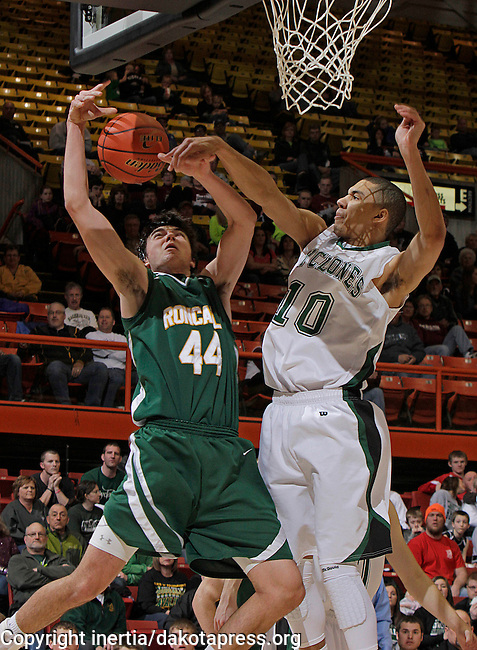 RAPID CITY, S.D. -- MARCH 16, 2013 -- Dominic King #44 of Aberdeen Roncalli gets blocked by Skyler Flatten #10 of Clark-Willow Lake during the 2013 South Dakota State A Boys Basketball Tournament in Barnett Arena at the Rushmore Plaza Civic Center Saturday. (Photo by Dick Carlson/Inertia)