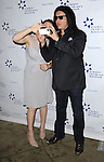 Gene Simmons and daughter Sophie Simmons at the '13th Annual Discovery Award Dinner' held at the Beverly Hills Hotel November 14, 2013