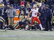 Annapolis, MD - November 11, 2017: Southern Methodist Mustangs wide receiver Trey Quinn (18) gets tackled by Navy Midshipmen cornerback Micah Farrar (32) during the game between SMU and Navy at  Navy-Marine Corps Memorial Stadium in Annapolis, MD.   (Photo by Elliott Brown/Media Images International)