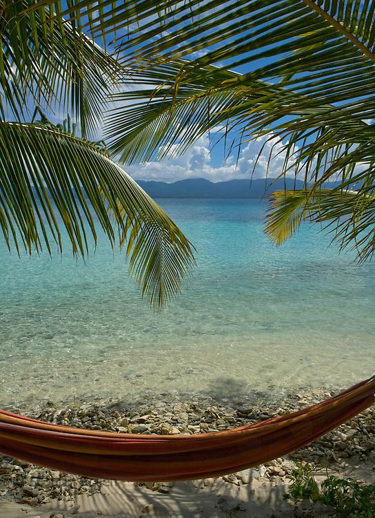 Hammock under palm trees on Isla Pelikano, San Blas Islands, Kuna Yala, Panama