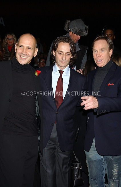 WWW.ACEPIXS.COM . . . . . ....NEW YORK, FEBRUARY 4, 2005 ....Carmen Marc Valvo, Luca Luca and Tommy Hilfiger exit The Heart Truth Red Dress Collection fashion show held in Bryant Park.....Please byline: KRISTIN CALLAHAN - ACE PICTURES.. . . . . . ..Ace Pictures, Inc:  ..Philip Vaughan (646) 769-0430..e-mail: info@acepixs.com..web: http://www.acepixs.com