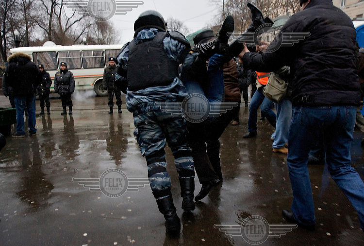 Members of Russia's OMON (Special Force) arrest protesters, who demonstrated against what they claimed to be rigged presidential elections. Russia went to the polls to vote for Vladimir Putin's chosen successor, Dmitry Medvedev. The protesters are part of the United Civil Front group (part of the opposition coalition The Other Russia) led by former world chess champion Garry Kasparov and writer Eduard Limonov.