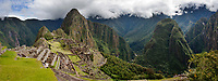 "Huayanapichu (young mountain) in the distance at Machu Picchu, the ancient ""lost city of the Incas"", 1400 CA, 2400 metersl. Discovered by Hiram Bingham in 1911. One of Peru's top tourist destinations."