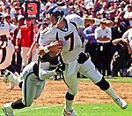 Oakland Raiders vs. Denver Broncos at Oakland Alameda County Coliseum Sunday, September 20, 1998.  Broncos beat Raiders  34-17.  Oakland Raiders defensive end Lance Johnstone (51) sacks Denver Broncos quarterback John Elway (7).