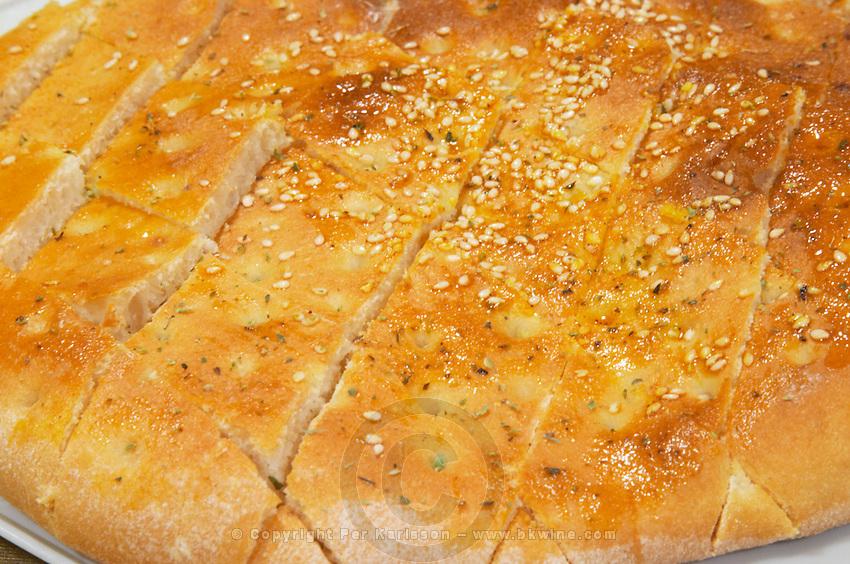 Traditional bread with sesame seeds. Efendi Efendy traditional Turkish and Ottoman Restaurant, The Block, Tirana. Albania, Balkan, Europe.