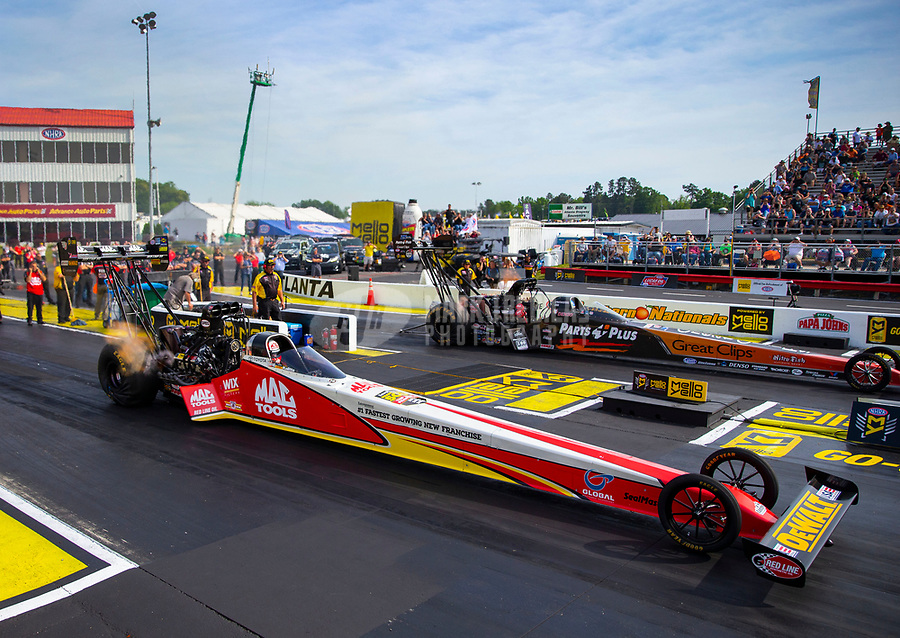 May 4, 2018; Commerce, GA, USA; NHRA top fuel driver Doug Kalitta (near) races alongside Clay Millican during qualifying for the Southern Nationals at Atlanta Dragway. Mandatory Credit: Mark J. Rebilas-USA TODAY Sports