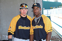 South Bend Silver Hawks catcher B.J. Lopez (26) and Chuck Taylor (11) pose for a photo before a game against the Lansing Lugnuts on June 6, 2014 at Cooley Law School Stadium in Lansing, Michigan.  South Bend defeated Lansing 13-5.  (Mike Janes/Four Seam Images)