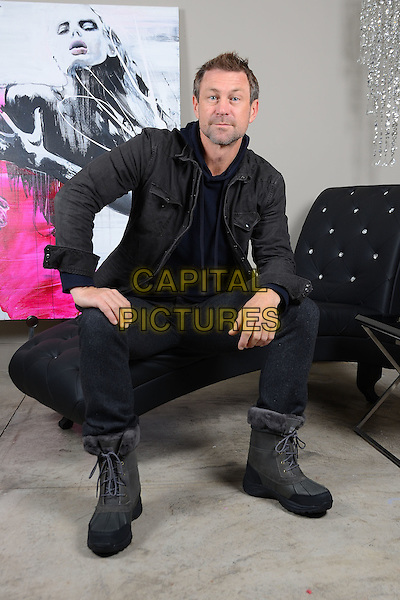 Grant Bowler.Gifting Services gifting suite,  West Hollywood, California, USA, .12th January 2012..full length sitting down  boots black jacket .CAP/ADM/BT.©Birdie Thompson/AdMedia/Capital Pictures.