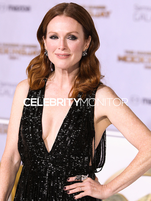 LOS ANGELES, CA, USA - NOVEMBER 17: Julianne Moore arrives at the Los Angeles Premiere Of Lionsgate's 'The Hunger Games: Mockingjay, Part 1' held at Nokia Theatre L.A. Live on November 17, 2014 in Los Angeles, California, United States. (Photo by Rudy Torres/Celebrity Monitor)