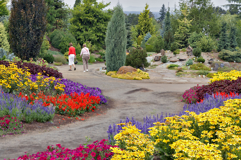 Two visitors strolling through Oregon Gardens.