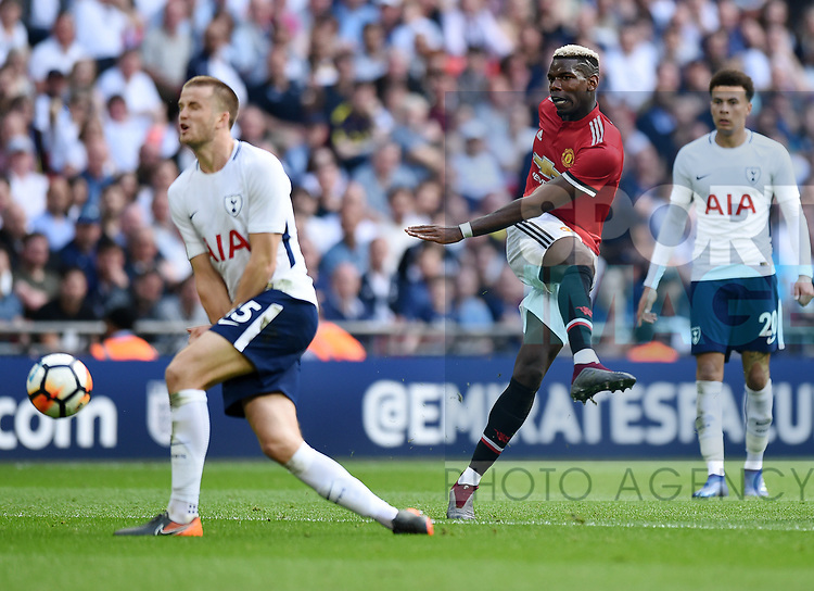 Paul Pogba of Manchester United is challenged by Eric Dier of Tottenham Hotspur during the FA cup semi-final match at Wembley Stadium, London. Picture date 21st April, 2018. Picture credit should read: Robin Parker/Sportimage