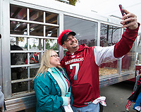 NWA Democrat-Gazette/BEN GOFF @NWABENGOFF<br /> Teresa Wheeler of Camden and Daniel Pranger of Benton take a selfie with Arkansas live mascot Tusk V Saturday, Nov. 29, 2019, before the game vs Missouri at War Memorial Stadium in Little Rock.
