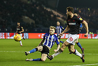 Bolton Wanderers' Yanic Wildschut crosses under pressure from Sheffield Wednesday's Ashley Baker <br /> <br /> Photographer Andrew Kearns/CameraSport<br /> <br /> The EFL Sky Bet Championship - Sheffield Wednesday v Bolton Wanderers - Tuesday 27th November 2018 - Hillsborough - Sheffield<br /> <br /> World Copyright &copy; 2018 CameraSport. All rights reserved. 43 Linden Ave. Countesthorpe. Leicester. England. LE8 5PG - Tel: +44 (0) 116 277 4147 - admin@camerasport.com - www.camerasport.com