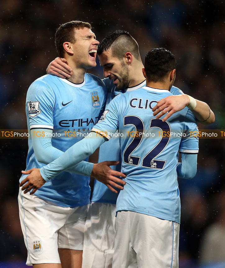 Edin Dzeko celebrates after scoring the 5th goal for Man City - Manchester City vs West Ham United, Capital One Cup Semi-Final 1st Leg at the Etihad Stadium, Manchester - 08/01/14 - MANDATORY CREDIT: Rob Newell/TGSPHOTO - Self billing applies where appropriate - 0845 094 6026 - contact@tgsphoto.co.uk - NO UNPAID USE