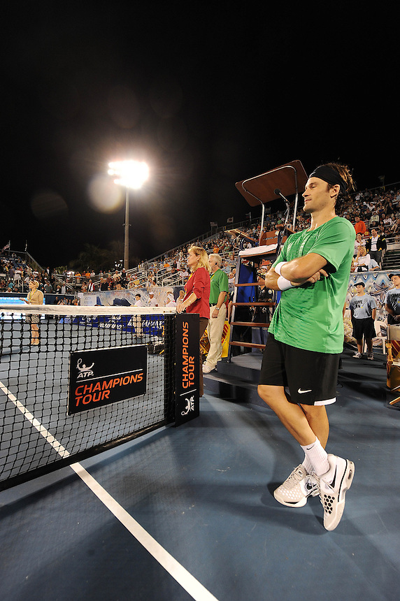 Carlos Moya (ESP) iwaits to receive his trophy after his victory over Ivan Lendl (USA) in their Final match today - Carlos Moya (ESP) def Ivan Lendl (USA) 6-4 6-4..Tennis - 2012 ATP Champions Tour - Day 5 - Tuesday 28 February 2012 - Delray Beach Stadium & Tennis Center - Delray Beach - Florida - USA ..