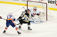 PITTSBURGH, PA - NOVEMBER 21:  Sidney Crosby #87 of the Pittsburgh Penguins scores his first goal of the season against Anders Nilsson #45 of the New York Islanders during the game on November 21, 2011 at CONSOL Energy Center in Pittsburgh, Pennsylvania. Crosby has not played a game since January 5th after sustaining a concussion.  (Photo by Jared Wickerham/Getty Images)