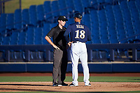 AZL Brewers Blue manager Raphael Neda (18) argues a call with umpire Cas Cousins during an Arizona League game against the AZL Athletics Gold on July 2, 2019 at American Family Fields of Phoenix in Phoenix, Arizona. AZL Athletics Gold defeated the AZL Brewers Blue 11-8. (Zachary Lucy/Four Seam Images)