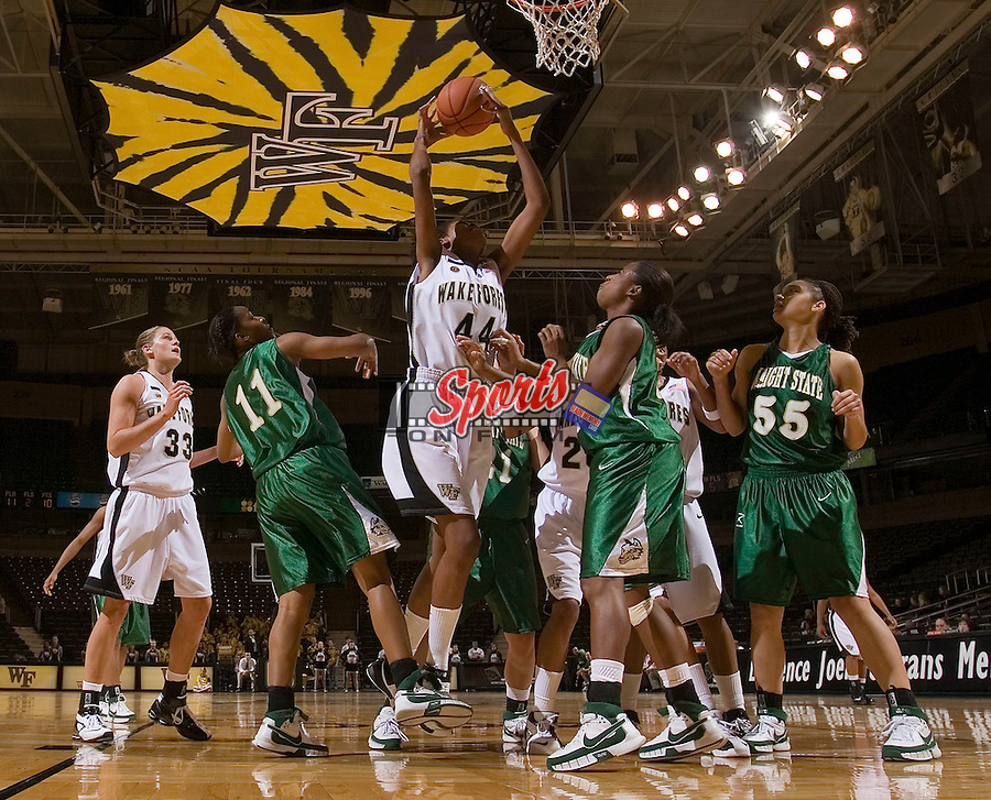Mekia Valentine (44) of the Wake Forest Demon Deacons grabs a rebound in a crowd during second half action versus the Wright State Raiders at the LJVM Coliseum on December 5, 2007 in Winston-Salem, NC.